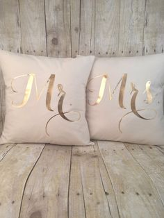 ::About::  These pillows are made with cream 100% Kona cotton and feature custom made shiny gold metallic foil design! They measure about 16x16 and