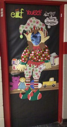 2015 WMP classroom Christmas door, Elf on the Shelf. I made the elf from gift wrap paper. The toys are made from construction paper. I think I will go back and add another shelf with more toys. Maybe a train or something. Looks empty at the bottom.