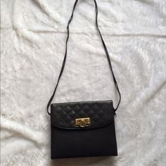 Vintage crossbody leather bag  Vintage crossbody black leather bag  Second picture of how to the front opens into a wallet, additional opening to hold everything else   Gently used  Please ask for additional pictures, measurements, or ask questions before purchase.  No trades or other apps  Ships next business day, unless noted in my closet   Bundle for discount Tianni Bags