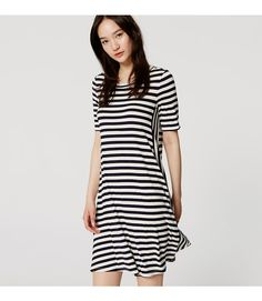 "Stripes are always in style, and this swingy dress makes them feel especially fresh with its mixed motif. Round neck. Short sleeves. 19 1/2"" from natural waist."