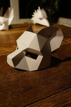 """U.K.-based designer Steve Wintercroft has a collection of bizarre geometrical paper masks for Halloween revelers that can be printed out (for a price) and assembled by you right at home. They're an inexpensive, creative and customizable solution to that all-important questions – """"What should I be for Halloween?"""" When you purchase a mask, you gain access to a .pdf file download that will let your print out and make the mask yourself."""