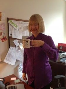Communications Director Anne Rudig was going to give up caffeine for Lent but changed her mind after getting the new 2013 Lent Madness mug!