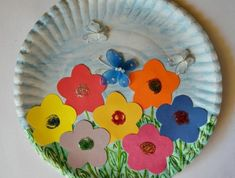 diy art projects, white paper plate, decorated with blue and green crayon, colorful flower-shaped cutouts, and small butterfly ornaments Easy Paper Crafts, Paper Plate Crafts, Paper Plates, Toddler Art Projects, Diy Art Projects, Projects To Try, Craft Activities, Preschool Crafts, Crafts For Kids