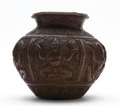 Beaten copper ritual water pot, or lota, decorated around the body with horizontal panels in repousse and subsequent chasing depicting figures from Hindu mythology: Maha Kala, Agni, Hanuman, Krishna and Vishnu | Horniman Museum and Gardens | CC0