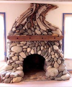 Stone & driftwood fireplace from www. Yurt Living, Earthship Home, Earth Homes, Natural Building, Living Room Remodel, Fireplace Design, Log Homes, Cheap Home Decor, My Dream Home