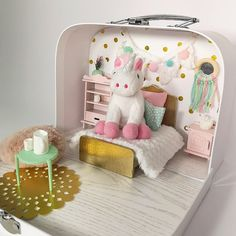 Unicorn Dollhouse in a suitcase. Travel Unicorn Dollhouse