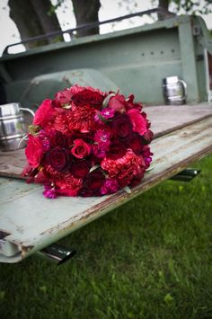 pickup truck bed with flowers and mugs. (Purple Martini Wedding & Event Photography/ Rachel A.Clingen Wedding & Event Decor)