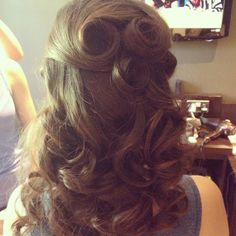 Half up half down vintage wedding hairstyle. I like how it allows for the pin curls and the half down - I would want my hair that is down to be more shapely though, not just a pile of curls