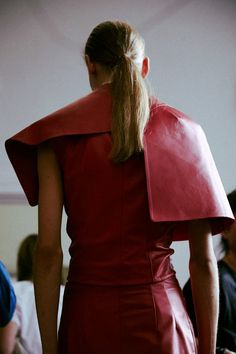 Red leather folds backstage at J.W.Anderson SS15 LFW. More images here: http://www.dazeddigital.com/fashion/article/21682/1/j-w-anderson-ss15