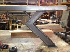 same style leg as the angle dining table. Reclaimed metal and wood