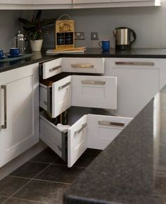 10 Tips for Remodeling Your Kitchen. Love the caddy corner idea but I'd change the handles.
