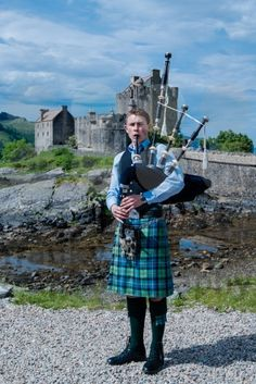 Bagpipe player in front of famous Eilean Donan Castle in the highlands of Scotland - royalty free photos by photography - buy and . Eilean Donan, Kilts, Highlands, Royalty Free Photos, Scotland, Castle, Photography, Stuff To Buy, Fashion