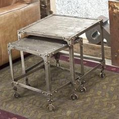 @Overstock - These pop rivet cornered industrial steel coffee tables are made from angled iron and etched cold-rolled steel. The nesting design allows for maximizing floor space with the flexibility of rolling out more counter space when needed.http://www.overstock.com/Worldstock-Fair-Trade/Industrial-Steel-Nesting-Side-Tables-India/5309995/product.html?CID=214117 $272.99