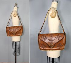 Hey, I found this really awesome Etsy listing at https://www.etsy.com/listing/181246142/vintage-bag-tooled-leather-western-sky