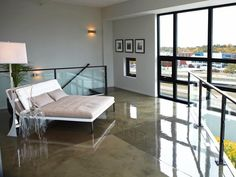 Chaise for Two ----Relax on the lover's chaise while taking in the Grand Rapids city view. The concrete floor's reflective epoxy finish gives you a feeling of floating on air.