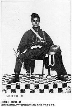 Samurai holding a muchi (whip).