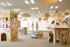 As part of a promotion for a Japanese masking tape manufacturer, art director Koji Iyama constructed a cardboard city and invited children to decorate. Cardboard Kids, Cardboard Animals, Cardboard Crafts, Cardboard Castle, Cardboard Boxes, Play Spaces, Kid Spaces, Art For Kids, Crafts For Kids