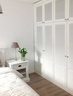 Bedroom flooring - White louvers, soft silver grey paint, planked vinyl floors and white furnishings Bedroom Closet Doors, Laundry Room Doors, Bedroom Closet Design, Bedroom Cupboards, Wardrobe Doors, Bedroom Wardrobe, Wardrobe Closet, Closet Designs, Wardrobe Design