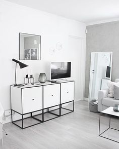 Frame 49 sideboard and Twin table in white. Photo credit: @fregnate