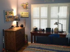 There is no better window covering than plantation shutters for a seaside-themed bedroom!