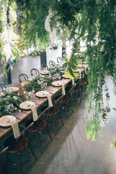 a stunning wedding reception draped in greenery | design by the style co via coco kelley