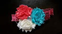 Check out this item in my Etsy shop https://www.etsy.com/listing/238665668/turquoise-pink-and-ivory-shaggy-rose