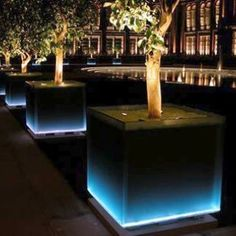 The LED lighting of the giant glass-sided planters that elegantly frame the entrance to the Victoria and Albert Museum in Kensington, London, are designed to create the appearance of a static water feature. The blue glow emanating from the evenly spaced p Backyard Lighting, Outdoor Lighting, Lighting Ideas, Landscape Designs, Landscape Architecture, Architecture Courtyard, Landscape Lighting Kits, Contemporary Landscape Lighting, Landscape Lighting Transformer