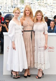 Style stars: The talented trio made a sartorial impact in their sensational midi dresses -...