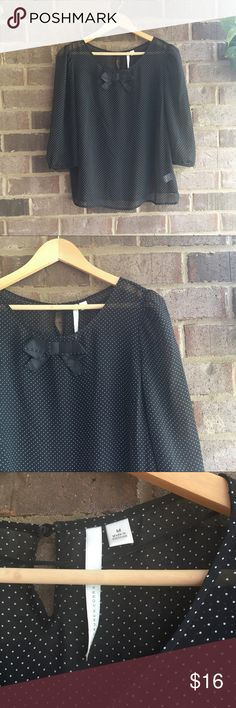 LC Lauren Conrad Black Polkadot Sheer Bow Blouse Made from polyester, this long sleeve top by LC Lauren Conrad is great for dressing up an outfit. The bow on the neckline really makes the piece. In great condition. Approximate measurements lying flat: 19' bust, 24' length 10690 LC Lauren Conrad Tops Blouses