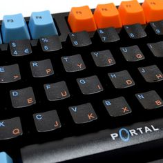 Portal themed keycaps from WASD keyboards.