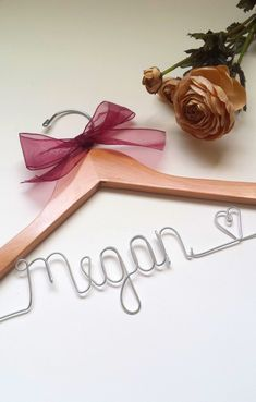 A special custom bridal hanger for the special bridesmaid! We will put any first name, along with a heart, on this hanger for you! *To make things easier for everyone,there is no additional charge for