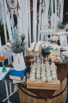 Mint & gold chocolate cake pops, tahitian vanilla cupcakes, french macarons - boho dessert table // bohemian sweet corner
