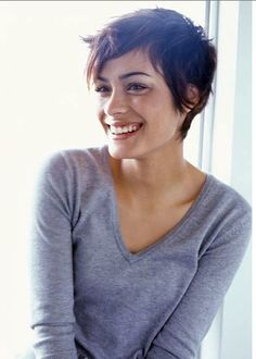 I'd like to grow out my hair, but it's so annoying and ridiculous right now, I may get something like this cute cut.
