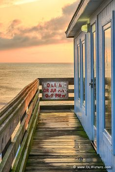 Sunrise on Kitty Hawk fishing pier on the Outer Banks of North Carolina.