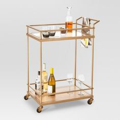 Get ready for any big gathering or enjoy a quiet night in with loved ones with this Wood & Glass Gold Finish Bar Cart from Threshold™. Perfect for adding to your living room or dining room, you'll love serving guests or yourself a delicious drink with the convenience of this bar cart. Whether you create an at-home coffee/tea station or a setup to enjoy homemade cocktails, this bar cart makes doing so a breeze — two levels let you store bottles, glassware and mo...