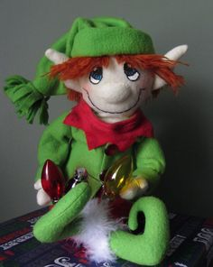 Green and Red Christmas Elf by javiegurl03 on Etsy, $23.00    I adopted this guy !  -- Couldn't put him away -- he's still sitting on a shelf in the living room