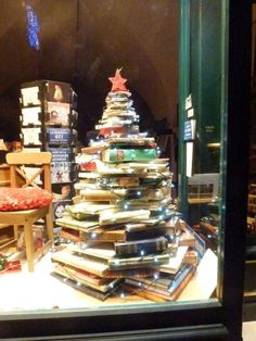 Lovely display in a bookstore window; could use books destined for bookbarn! Christmas Window Display Retail, Christmas Shop Displays, Store Window Displays, Winter Window Display, Book Christmas Tree, Book Tree, Christmas Windows, Xmas Tree, Christmas Decorations