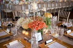 The long rectangular head table in the center of the room was the focal point of the reception with even taller arrangements and a long runner of floral and ...