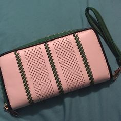 Like new Charming Charlie wallet! Charming Charlie wallet only used a couple of times! Outside is white and green. Inside is tan with black and white stripes! Has 8 card slots, coin slot, and a few other spaces for cash and receipts!! Charming Charlie Bags Wallets