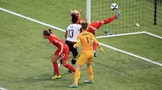 Steph Houghton of England clears the ball off the line
