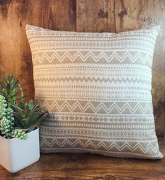 The Mesa Pillow Cover <<  Tan and white Aztec pattern with a gold metallic hidden zipper.  Product Details: Material | 69% Poly, 25% Cotton, and 6%