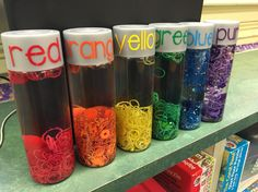 Rainbow sensory bottles made from voss water bottle