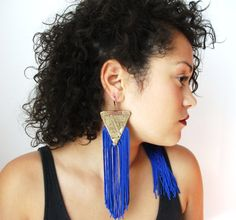 Here's some cool earrings from another seller on Etsy: Triangle earrings, fringe earrings, fabric earrings, vintage gold fabric, cobalt fringe. $25.00, via Etsy.