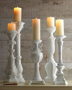 white candle holders - bet you could find tons of uglies at goodwill and then paint them.  Or maybe a verdi gris, seafoamy color?