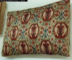 """CUSHION. Westphalia, 14th to 15th century. Berlin, Schloss Charlottenburg, Kunstgewerbemuseum (88.663). 28 x 40 cm. Grey linen canvas. Embroidered with untwisted floss silk in brick stitch. Colors: green, yellow, red, white. On the underside, striped Spanish silk. From the Treasury of Enger. Acquired from the Dionysianisches Kapitel der Johanneskirche in Herford."""