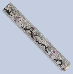 AN EXQUISITE ART DECO DIAMOND AND GEM-SET BRACELET, BY LACLOCHE Designed as a diamond-set articulated band depicting a Chinese pagoda and boat surrounded by an Oriental garden of trees in bloom and a sun setting over water, set with calibré-cut emeralds, rubies and onyx, circa 1925, 18.2cm. long, with French assay marks for platinum and gold Signed Lacloche Fres No. 67439 Photo courtesy of Christie's