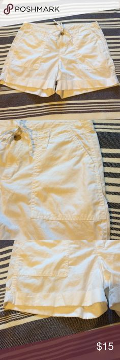 Classic White Cargo Shorts NWOT Great lightweight shorts that go with everything. Cargo pockets. Drawstring waist plus button and zipper. Back pockets. Cuffed hem. Old Navy Shorts Cargos