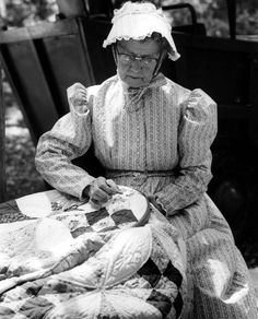Woman sewing a quilt at the Florida Folk Festival (ca. 1950). | Florida Memory