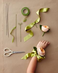 A wrist corsage is only as old-fashioned as its design. Materials: 18-gauge floral stem wire 1/2 inch-wide floral tape Thick ribbon Wire cutters A hearty rose, orchid, or gardenia Lemon leaves See More: Drape, Dangle, And Entwine! 3 DIY Streamers To Decorate Your Celebration 1. Tightly wrap one wire