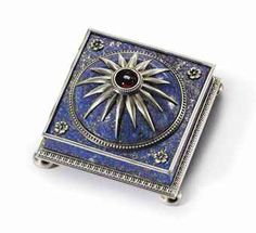 Joan Rivers collection. A JEWELED SILVER-GILT MOUNTED LAPIS LAZULI BELL-PUSH MARKED FABERGÉ, WITH THE WORKMASTER'S MARK OF VICTOR AARNE, ST. PETERSBURG, 1899-1904, SCRATCHED INVENTORY NUMBER 2154 Square, the domed top with silver sunburst motif and cabochon garnet push-piece, the square base set with rosettes at the corners and reeded bord